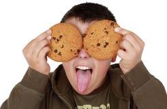 El jugar adolescente con las galletas Imágenes de archivo libres de regalías