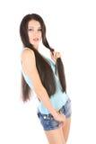 El jugar con el pelo largo Foto de archivo libre de regalías