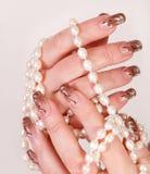 El jugar con las perlas Fotografía de archivo