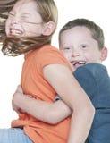 El jugar de la chica joven y del muchacho Foto de archivo libre de regalías