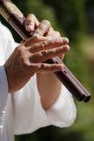 El jugar de la flauta Imagen de archivo libre de regalías