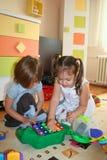 El jugar de las muchachas Fotografía de archivo libre de regalías