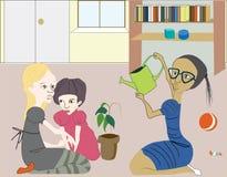 El jugar de los niños, regando una planta Imágenes de archivo libres de regalías