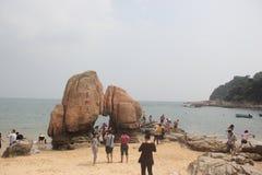 El jugar de los visitantes en parque de la playa Imagen de archivo libre de regalías