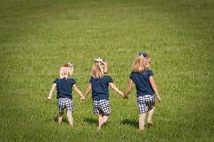 El jugar de tres hermanas Imagen de archivo libre de regalías