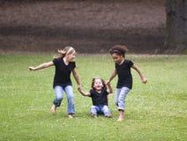 El jugar de tres muchachas Imagen de archivo libre de regalías