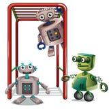 El jugar de tres robots Imagen de archivo libre de regalías