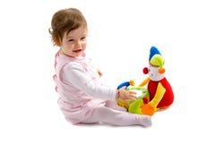 El jugar del bebé aislado Imagen de archivo libre de regalías