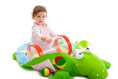 El jugar del bebé aislado Foto de archivo libre de regalías