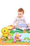 El jugar del bebé del Redhead Imagen de archivo