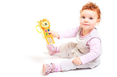 El jugar del bebé del Redhead Foto de archivo