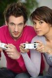 El jugar del hombre y de la mujer fotografía de archivo libre de regalías