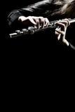 El jugar del instrumento de la orquesta de la flauta Fotografía de archivo