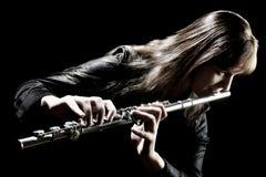 El jugar del músico del flautista del instrumento de música de la flauta Imágenes de archivo libres de regalías