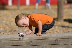 El jugar del muchacho Fotografía de archivo