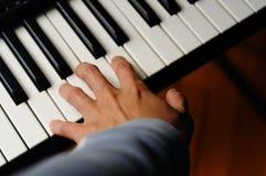 El jugar del piano Imagenes de archivo