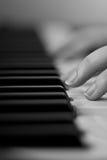 El jugar del piano Fotografía de archivo