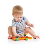 El jugar divertido del músico del bebé Imágenes de archivo libres de regalías