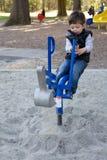 El jugar en el parque Foto de archivo