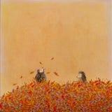 El jugar en hojas de otoño Imágenes de archivo libres de regalías