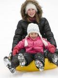 El jugar en nieve Imagen de archivo libre de regalías