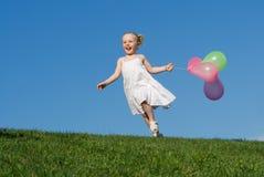 El jugar feliz del niño Fotografía de archivo libre de regalías