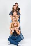 El jugar femenino de cinco amigos Fotografía de archivo