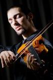 El jugar joven del jugador del violín Foto de archivo libre de regalías