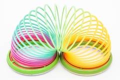 El juguete iridiscente del niño es una primavera imagen de archivo