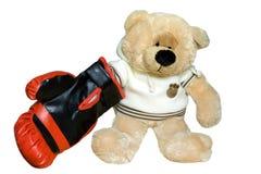 El juguete que un oso juega Foto de archivo libre de regalías