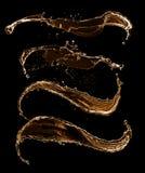 El líquido de oro salpica en fondo negro Fotos de archivo libres de regalías