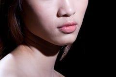 El labio de la muchacha imagenes de archivo