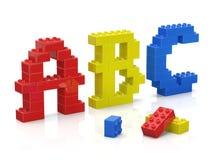 El ladrillo colorido juega alfabeto Fotos de archivo