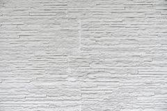 El ladrillo de piedra clásico blanco se arregla para modelar en la pared para el fondo mínimo y simple hermoso foto de archivo