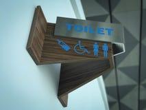 El lavabo público firma con un símbolo discapacitado del acceso foto de archivo