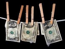El lavar planchar de dinero Imagen de archivo libre de regalías