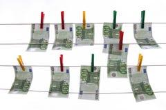 El lavar planchar de dinero Fotos de archivo