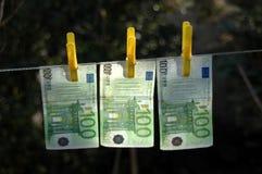 El lavar planchar de dinero Foto de archivo libre de regalías
