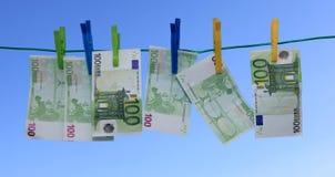 El lavar planchar de dinero Imagen de archivo