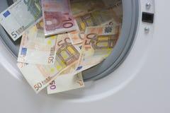 El lavar planchar de dinero. Concepto de la limpieza del dinero Fotos de archivo