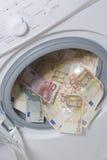 El lavar planchar de dinero. Concepto de la limpieza del dinero Fotos de archivo libres de regalías