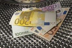 El lavar planchar de dinero euro Fotografía de archivo libre de regalías