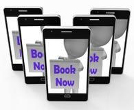 El libro ahora llama por teléfono a demostraciones hace la cita o la reserva Fotografía de archivo