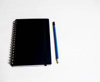 El libro negro con se corrige Fotografía de archivo