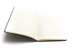 El libro o el planificador en blanco se abrió aislado en el fondo blanco Fotos de archivo