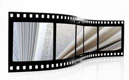 El libro pagina la tira de la película Foto de archivo