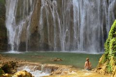 El Limon waterfall on Dominican Republic. Tourist swimming in the Salto el Limon the waterfall located in the centre of the tropical forest, Samana, Dominikana Stock Photo
