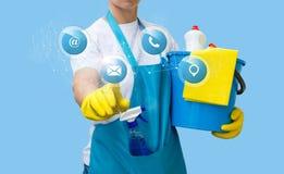 El limpiador hace clic en el icono de los contactos imagen de archivo
