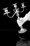 El llevar de la mano candelabros Imagenes de archivo