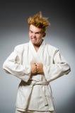 El llevar divertido del combatiente del karate Foto de archivo